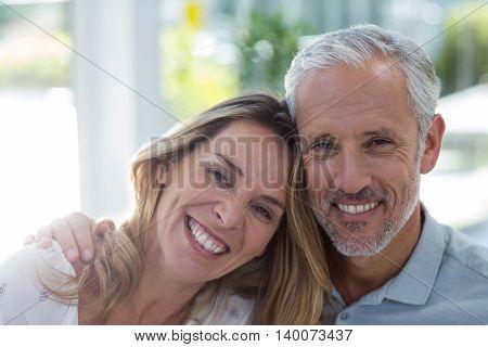 Close-up portrait of smiling mature couple in restaurant