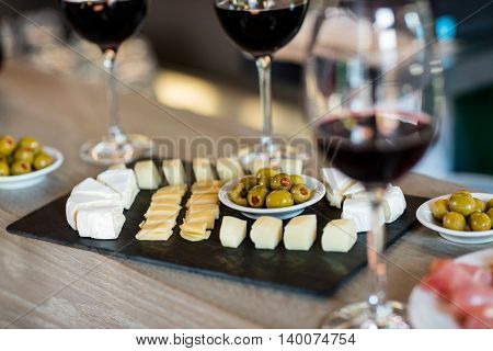 Close- up of wine and food arranged on table