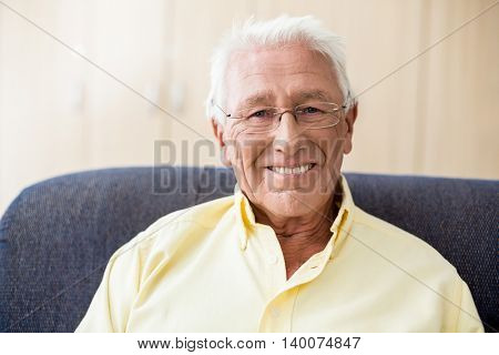 Senior smiling at camera in a retirement home