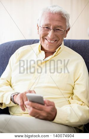 Senior using a smartphone in a retirement hom