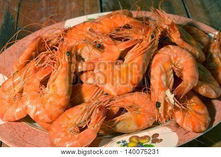 shrimp boil, Big boiled shrimps . Wood background top view.