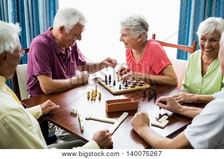 Seniors playing games in a retirement home