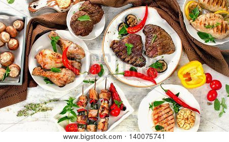 Assorted Grilled Meats And Vegetables On  Wooden Background.