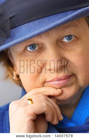 Middle age woman in hat