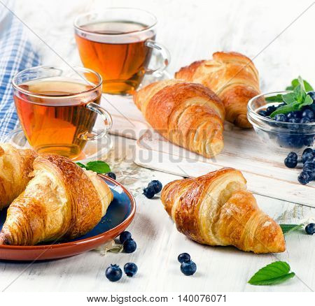 Fresh Croissants With Cups Of Tea For A Breakfast.