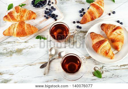 Fresh Croissants And Cups Of Tea  For Breakfast.