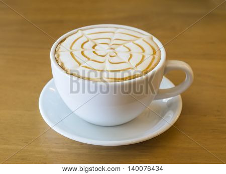 Coffee cup on wooden table ,soft focus