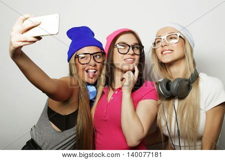 hipster girls best friends taking selfie