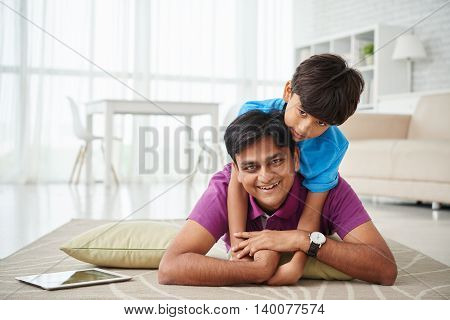 Preteen boy enjoying spending time with his father