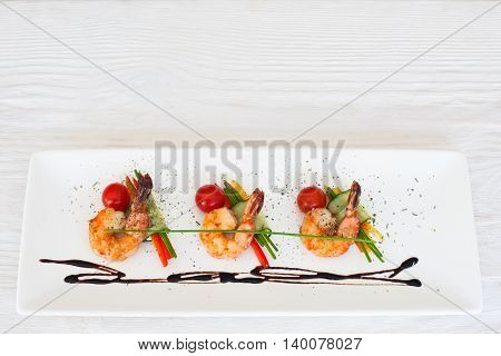 Meal of roasted prawns on white wooden background copyspace, flat lay. Menu of seafood restaurant concept