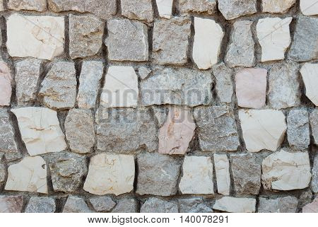 close up of granite stone wall with mortar