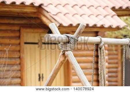 Wooded swing detail at backyard garden