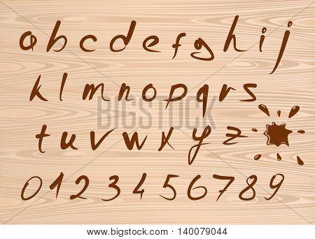 Hand drawn grunge brown font alphabet. vector alphabet on a wooden background