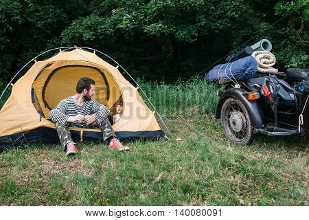 Family trip, child discovering the world. Interesting travel on sidecar in wild nature with dad, camping in forest