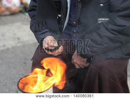 Poor Man In The Street Using A Mobile Phone And Heats Up