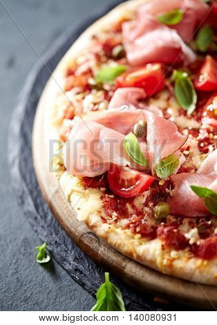 Pizza with Black Forest Ham, Cherry Tomatoes and Capers