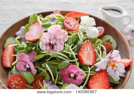 Sunflower Sprouts, Strawberries And Edible Flowers Salad On Wooden Bowl
