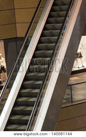 Empty escalator steps in a shopping mall
