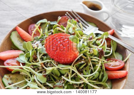 Sunflower Sprouts And Strawberries Salad On Wooden Bowl