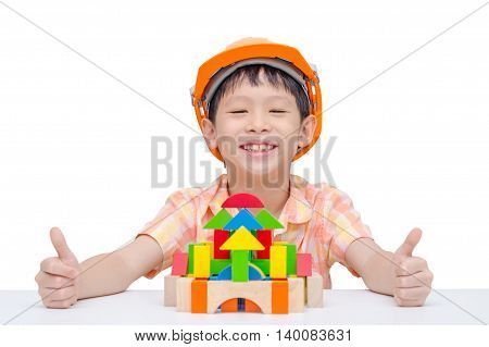 Young Asian boy playing construction blocks over white