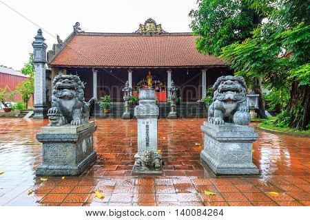 The lion statue in old pagoda at Hanoi, Vietnam