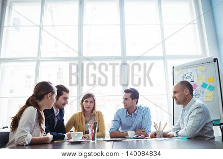 Business people discussing in meeting room at creative office