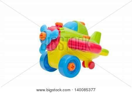 Colorful plastic aeroplane toy isolated over white