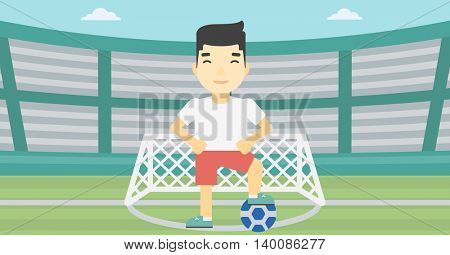 An asian sportsman standing with football ball on the football stadium. Young professional football player with a soccer ball on the field. Vector flat design illustration. Horizontal layout.