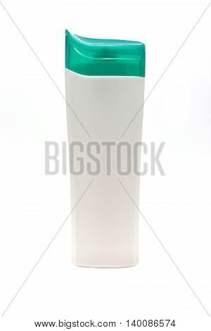 shampoo in a white bottle with green cap isolated