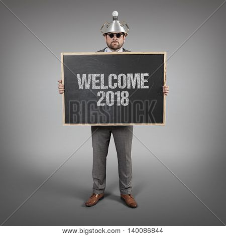 Welcome 2017 text on blackboard with science businessman holding blackboard sign