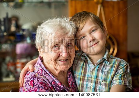 Portrait of an elderly woman with her little grandson.