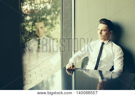 Man Looks Out Window