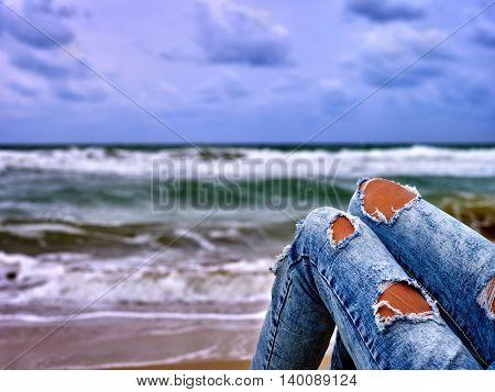 Summer girl sea. Girl sitting on coast near ocean with sea waves. Girl hot dog leg selfie on sea beach.