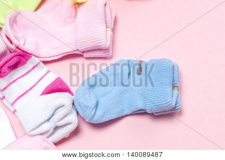 Cotton Baby Socks For Newborn On A Colorful Pink Background. Copy Space For Text. Top View