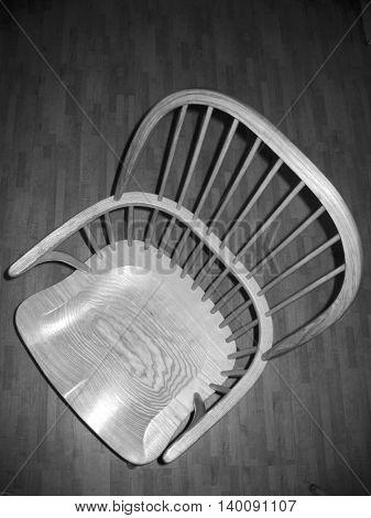 Gray-scale picture of an empty chair seen from above