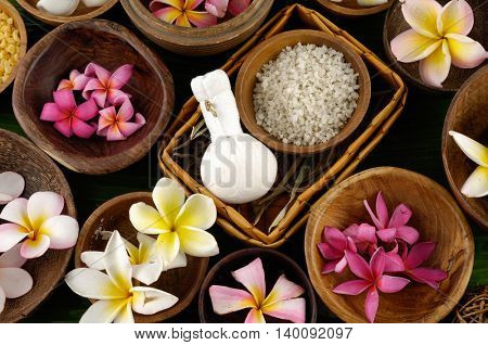 spa setting with salt in wooden bowl