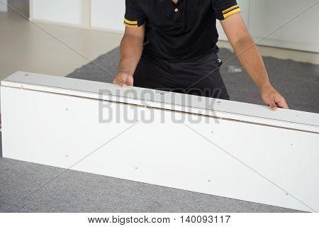 Hands Of Man Assembling New Furniture