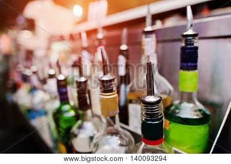 Close Up Bottles Of Alcohol And Liquor At The Bar