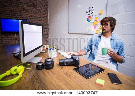 Young man using computer in creative office