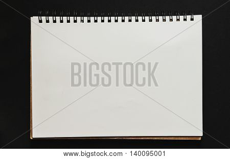 Scratch paper pad on black background, with copy space