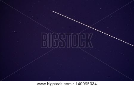 Shining stars on sky with plane coming throudh
