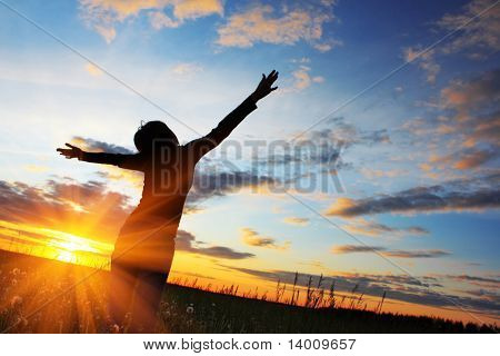 Young woman under sunset light