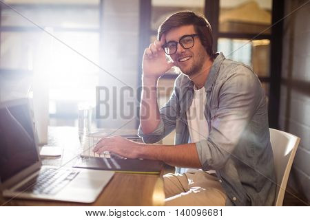 Portrait of smiling young man working in creative office