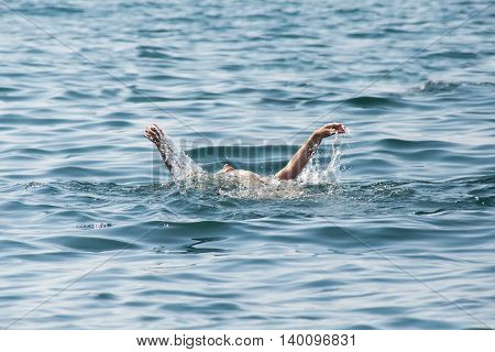 Young Woman Swimming In Ocean