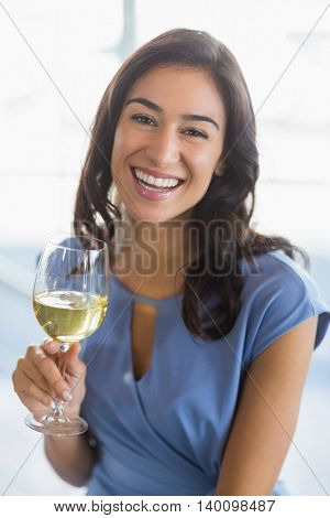 Portrait of smiling woman holding a beer glass in restaurant