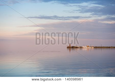 The pier at the evening calm sea