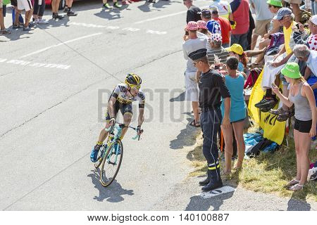 Col du Glandon France - July 23 2015: The Dutch cyclist Steven Kruijswijk of Lotto NL-Jumbo Team riding in a beautiful curve at Col du Glandon in Alps during the stage 18 of Le Tour de France 2015.