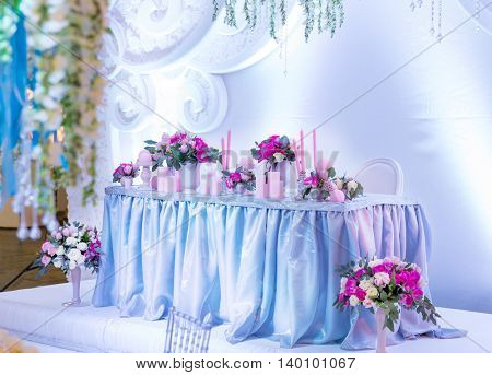 Many bouquets on the table in wedding room