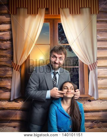 Businessman making a woman smile near the house