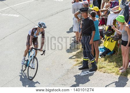 Col du Glandon France - July 23 2015: The French cyclist Alexis Vuillermoz of AG2R La Mondiale Team riding in a beautiful curve at Col du Glandon in Alps during the stage 18 of Le Tour de France 2015.